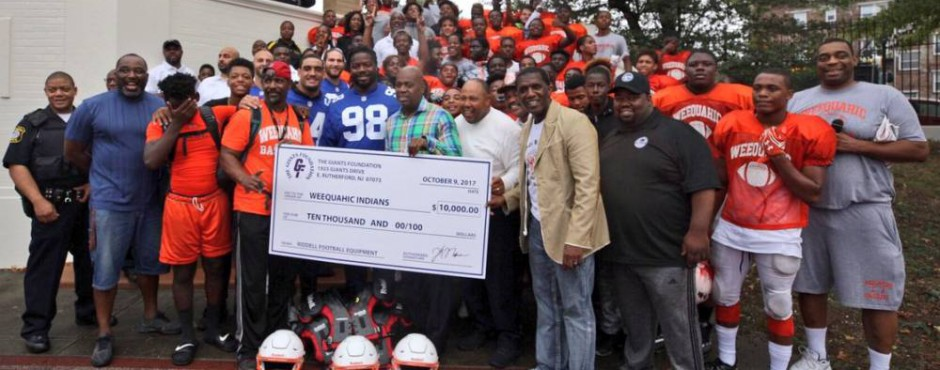 Giants donate $10,000 to football team